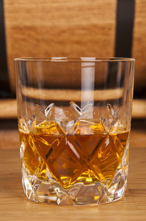 potbellied: glass of whiskey and barrel Stock Photo
