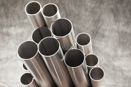 steel pipes on grey background