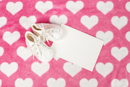 pair of baby shoes on pink fur Stock Photo