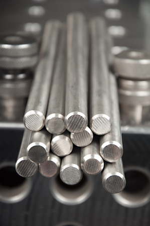 stainless steel rods on a welding table Stock Photo
