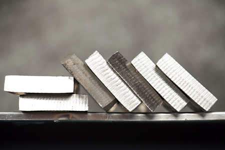 pieces of stainless steel on shelf Stock Photo
