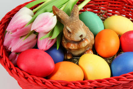 hen's: Easter eggs and tulips in a basket