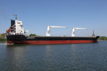 kiel: freighter with cranes on Kiel Canal, Germany