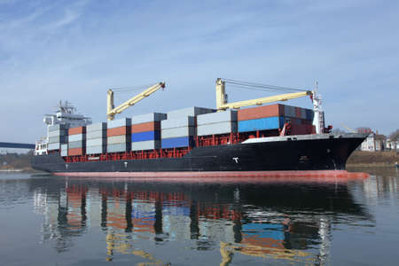 shipload: loaded container ship with cranes
