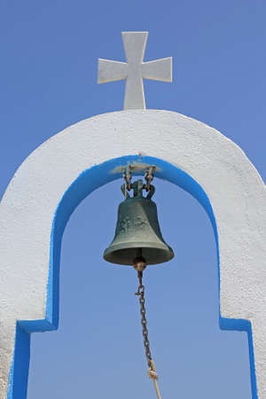 cross and bell of a small greek church