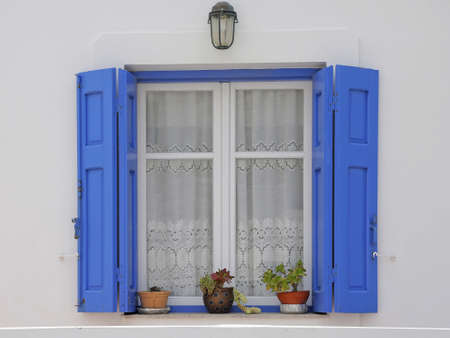 typical greek window with shutter