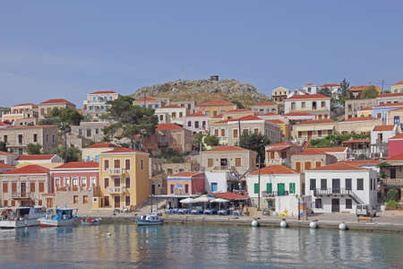 the picturesque harbor of the greek island Chalki Stock Photo