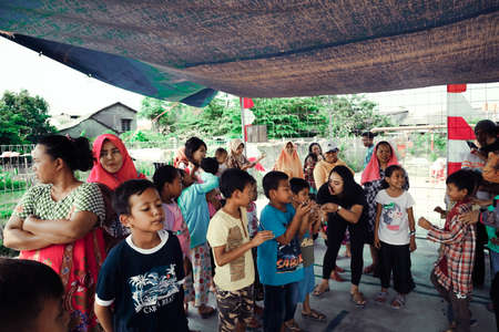 Jakarta, Indonesia - August 17, 2018: little children are competing to bring spoons with marbles on Indonesian independence day Editorial