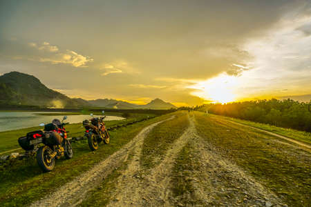 Purwakarta, West Java, Indonesia (03302018) : The rider is touring with his motorcycle through the Jatiluhur Dam side which is commonly called Parang Gombong