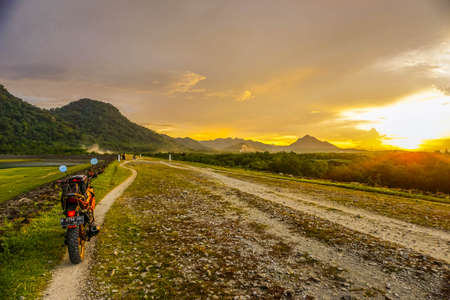 Purwakarta, West Java, Indonesia (03302018) : Purwakarta, West Java, Indonesia (03302018) : The rider is touring with his motorcycle through the Jatiluhur Dam side which is commonly called Parang Gombong
