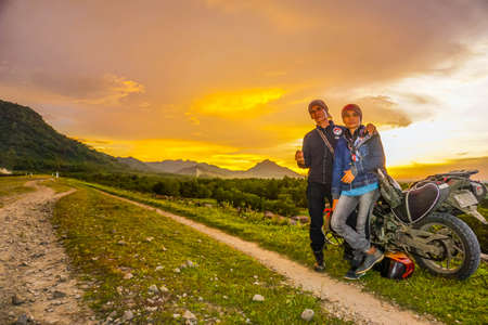 Purwakarta, West Java, Indonesia (03302018) : Couple lover with his motorcycle enjoying such beautiful sunset in Jatiluhur Dam