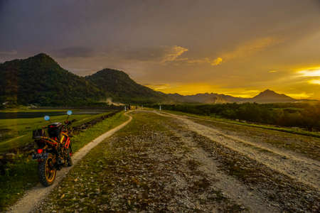 Purwakarta, West Java, Indonesia (03302018) : Motorcycle on the side of the Jatiluhur Reservoir with a beautiful sunset