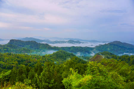 Beautiful landscape in the mountains at sunrise. Buluh Payung Hill, Kebumen, Central Java, Indonesia Stock Photo