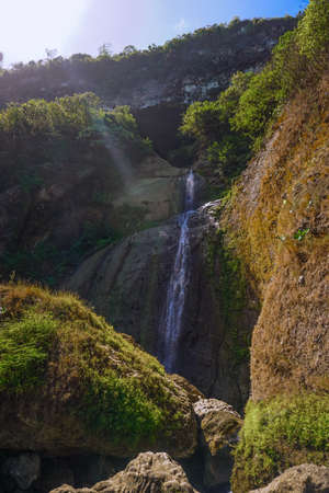Beautiful landscape waterfall Sawangan. A unique waterfall coming from a cave in Kebumen, Central Java, Indonesia Stock Photo
