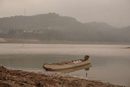 Boats that Lean in Sempor Dam, Kebumen, Central Java, Indonesia Stock Photo