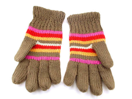bright knitted gloves with colorful stripes. Isolated photo