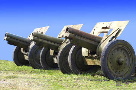 gunnery: russian cannons from second world war on peaceful sky background