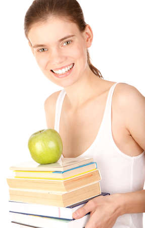 Pretty girl with books and green apple photo