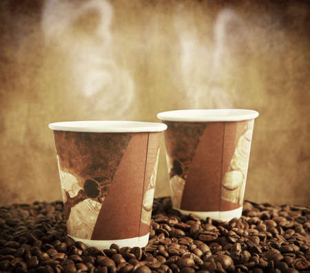 take away: paper cups in coffee beans Stock Photo