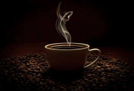 steaming coffee: aromatic cup of coffee with smoke and beans