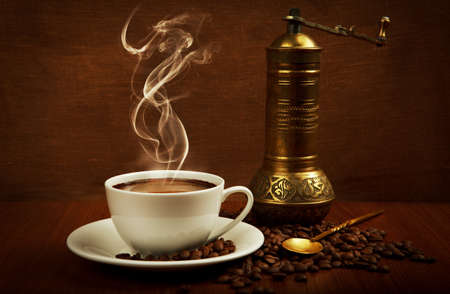 steaming coffee: cup of coffee with oriental mill Stock Photo