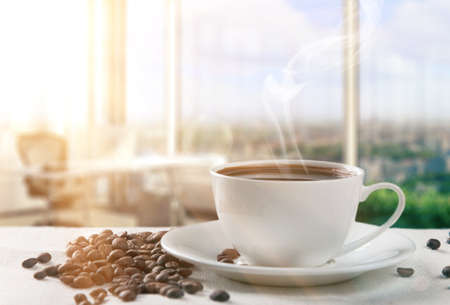 steaming cup of coffee: sunny morning with cup of coffee