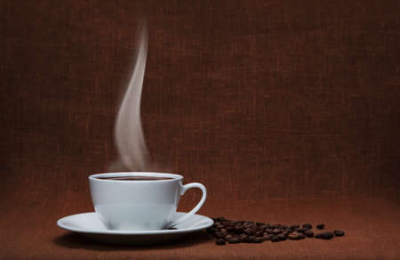 steaming coffee: steaming coffee with beans and copy space