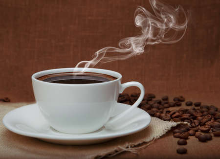 steaming coffee: steaming coffee on flax background