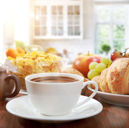 healthy breakfast with coffee in sunny morning photo