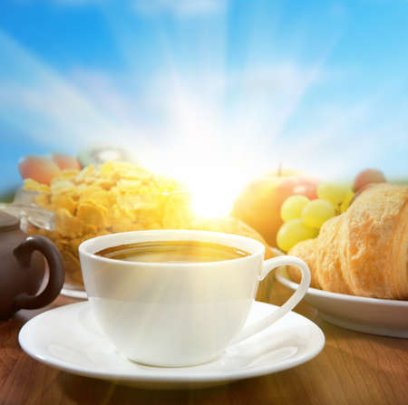 sunny breakfast with coffee and fruits photo