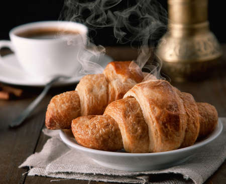 steaming coffee: morning croissants with coffee