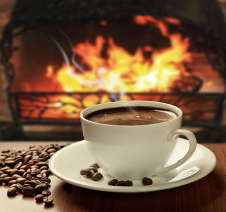 hot coffee near fireplace photo
