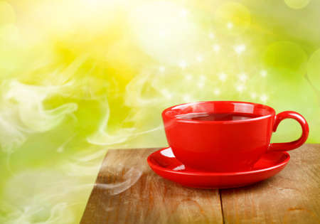 cup of tea or coffee on magic sunny background photo