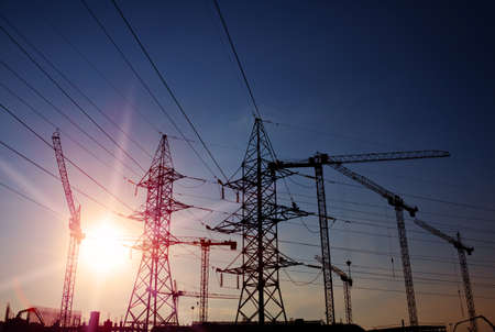 silhouettes of cranes and power towers Stock Photo - 22082691