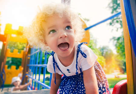 funny  little girl at playground photo