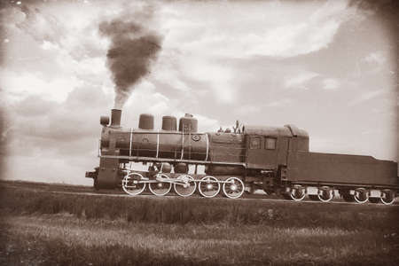 black train: Steam train in vintage sepia. Textured with old paper and retro scratches.