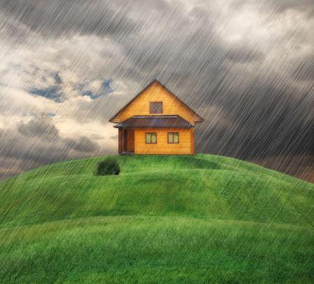 the weather: casa en una colina en el día de lluvia