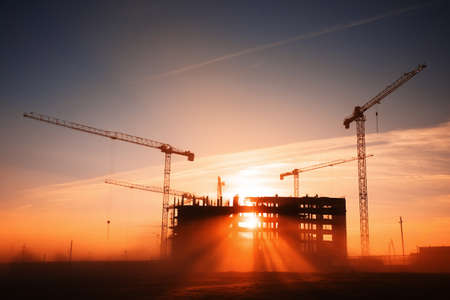 construction industry: tower cranes at construction site Stock Photo