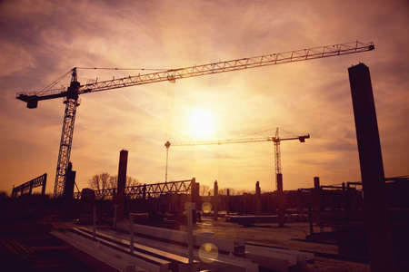 tower cranes at construction site Stock Photo