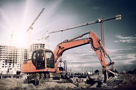 excavator on construction site 스톡 콘텐츠