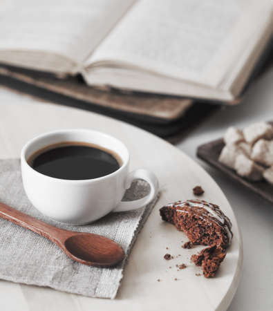 morning coffee: fresh coffee with cookie and book