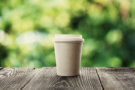 coffee table: paper cup of coffee on natural background Stock Photo