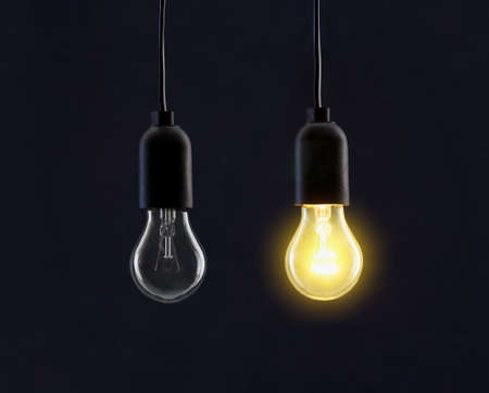 Light bulb lamps on black background