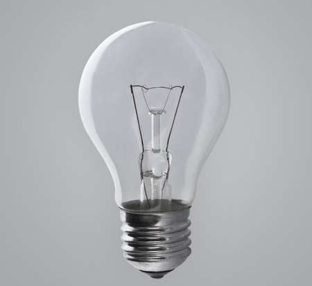 electric fixture: Light bulb lamp on grey background