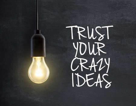 innovation: Light bulb lamp on blackboard background with idea quote