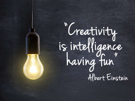 creativity: Light bulb lamp on blackboard background with creativity quote