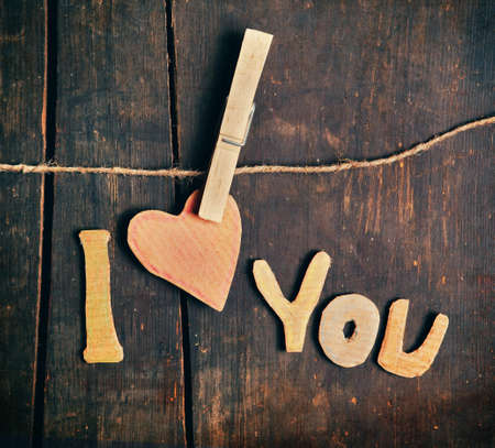 paper board: paper words I love you on wooden board Stock Photo
