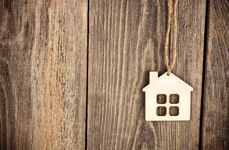 house as symbol on wooden background Archivio Fotografico