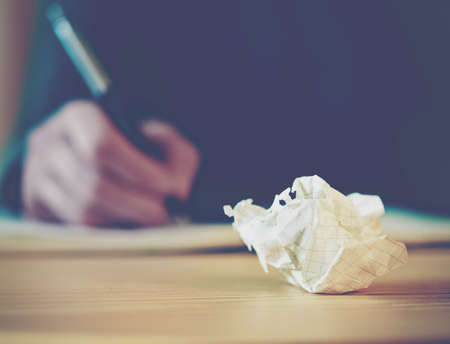 person writing: Paper ball during writing Stock Photo