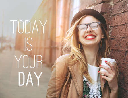 enjoy: Woman in the street drinking morning coffee in sunshine light with motivational text